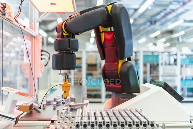 Arm of assembly robotpickingup machine part, Stuttgart, Germany — стокове фото