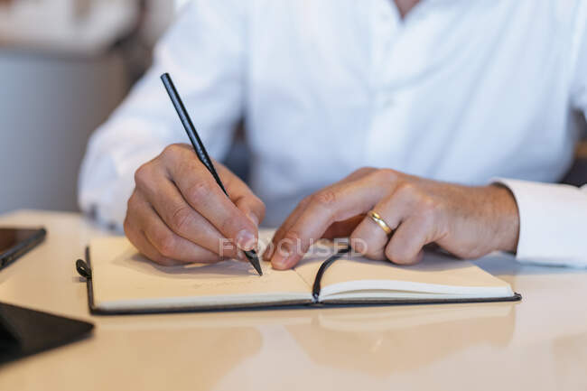 Close-up of businessman taking notes — Stock Photo