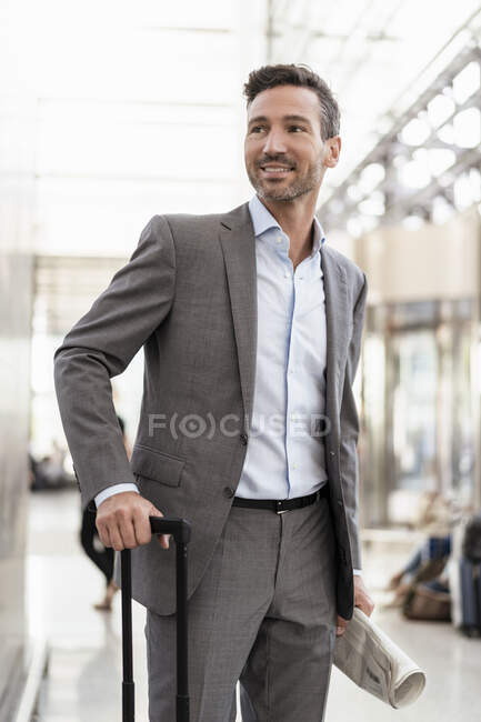 Portrait of smiling businessman with baggage — Stock Photo