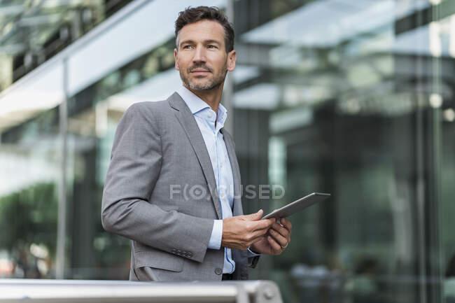 Portrait of confident businessman holding tablet — Stock Photo