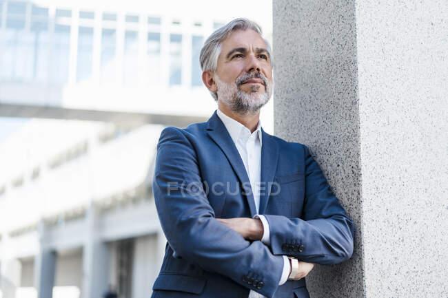 Portrait of mature businessman outdoors — Stock Photo