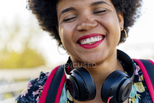 Laughing Afro-American woman with headphones — Stock Photo