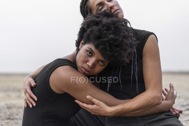 Portrait of two women hugging each other — Stock Photo