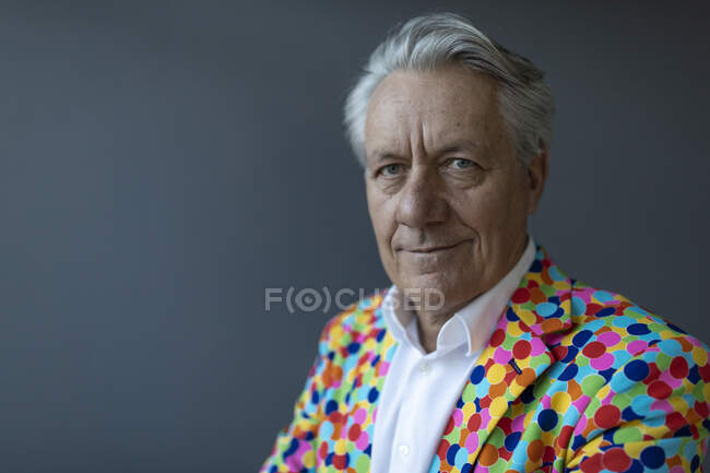 Portrait of a senior businessman wearing colorful sports jacket — Stock Photo