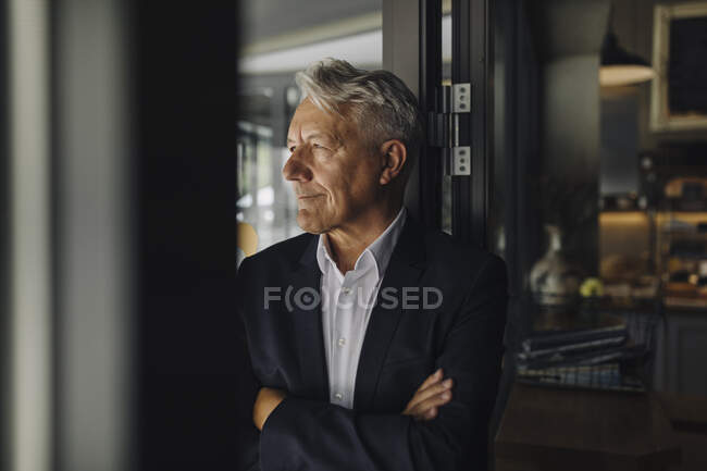 Portrait of confident senior businessman in a cafe — Stock Photo