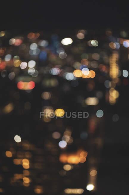Defocused cityscape at night, Manhattan, New York City, USA — Stock Photo