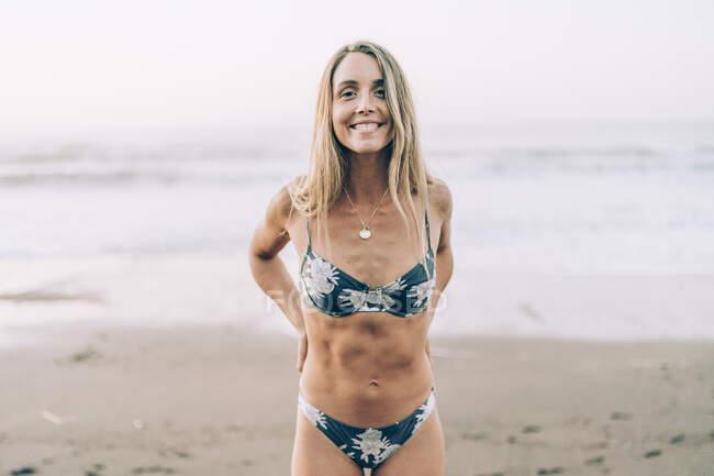 Young blond woman wearing bikini at the beach — Stock Photo
