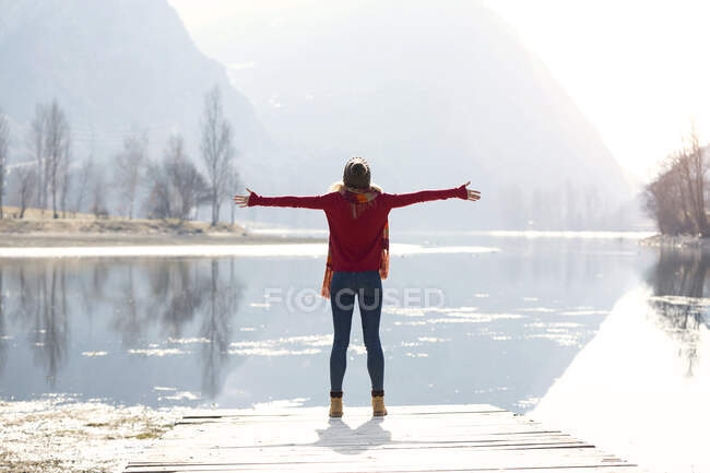 Young blond woman at a lake in winter — Stock Photo