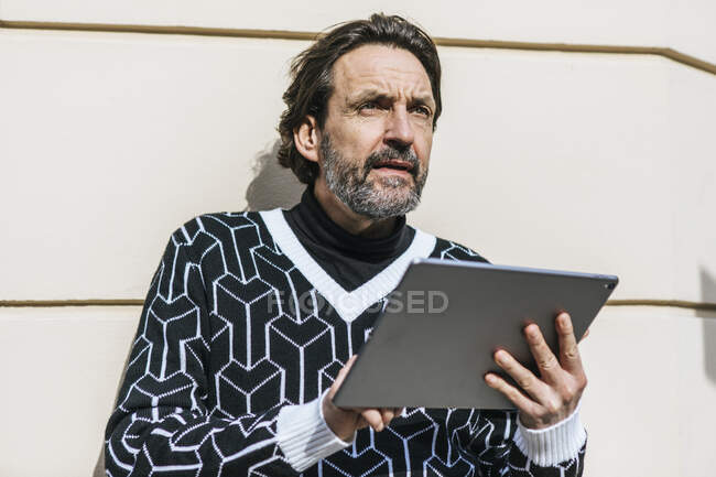 Portrait of fashionable mature man with digital tablet — Stock Photo