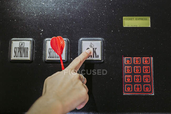 Close-up of woman's hand switching on electronic dartboard — Stock Photo