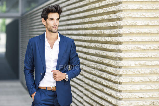 Young man wearing blue suit outdoors — Stock Photo