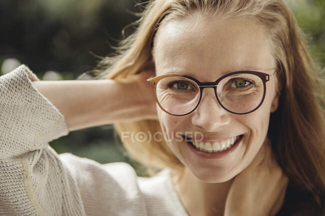 Portrait of happy young woman with glasses — Stock Photo