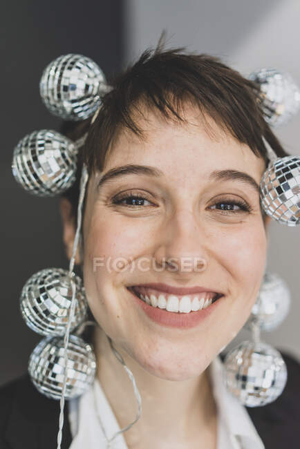 Portait of happy young businesswoman  wearing mirror balls — Stock Photo