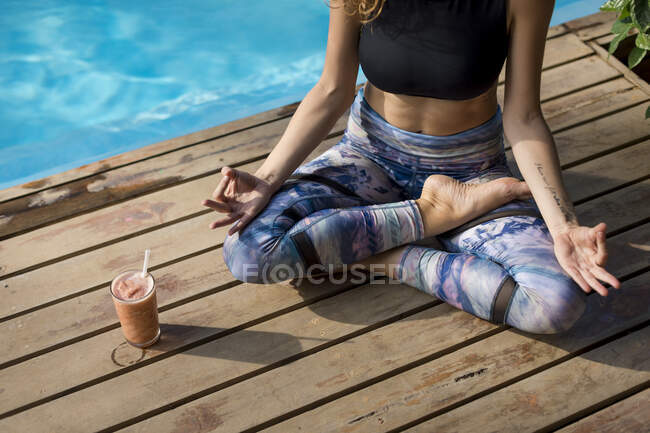 Woman practicing yoga at poolside, Costa Rica — Stock Photo