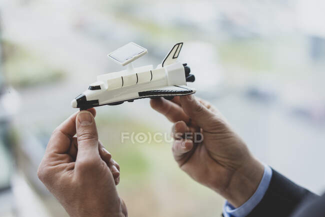 Close-up of bussinessman holding space shuttle model — Stock Photo