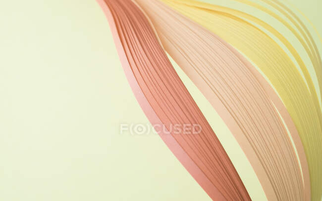 Close-up of colorful quilling papers on beige background — Stock Photo