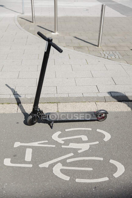 E-scooter parked on bicycle lane in the city — Stock Photo