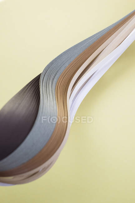 Close-up of various quilling papers on beige background — Stock Photo