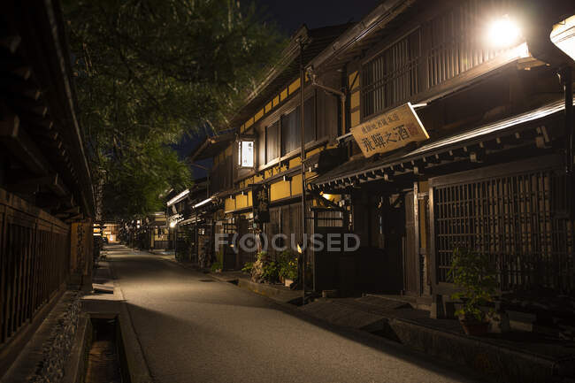 Japan, Takayama, Illuminated street of Japanese village at night — Stock Photo