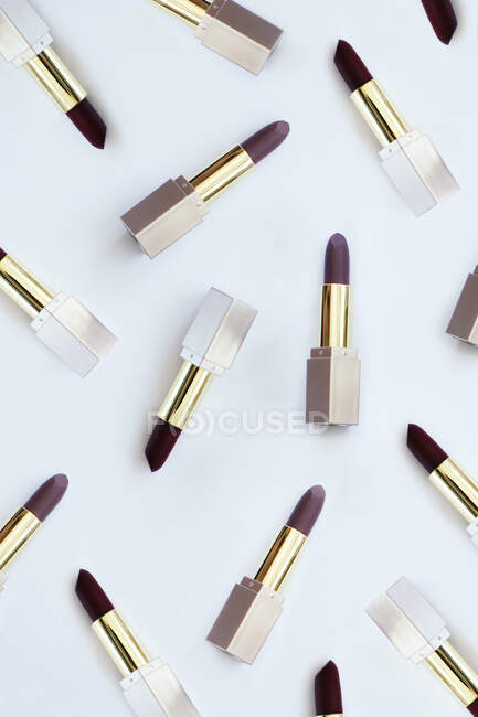 Lipsticks scattered on a white background — Stock Photo