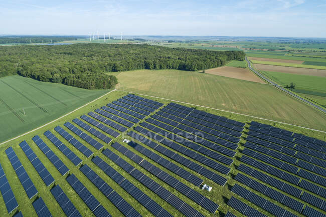 Germany, Bavaria, Aerial view of countryside solar farm in spring — Stock Photo