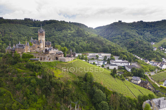 Aerial view of castle on mountain against cloudy sky in town, Cochem, Germany — Stock Photo