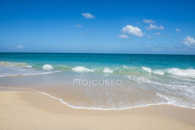 Scenic view of seascape against blue sky during sunny day, Grenada, Caribbean — Stock Photo