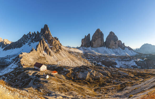 Scenic view of Tre Cime di Lavaredo and Mount Paterno against clear blue sky, Italy — Stock Photo