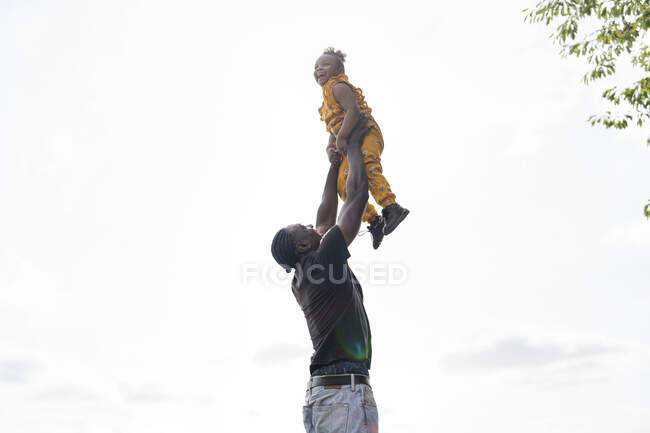 Father lifting up happy daughter — Stock Photo