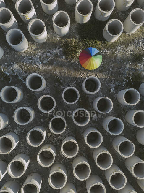 Aerial view of umbrella and concrete hoops — Stock Photo
