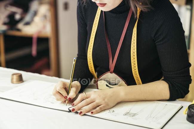 Crop view of fashion designer at work — Stock Photo