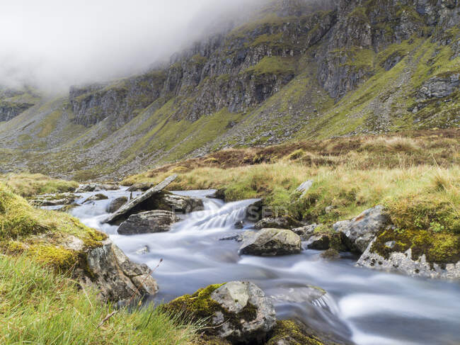 Scenic view of river against mountain, Scotland, UK — Stock Photo