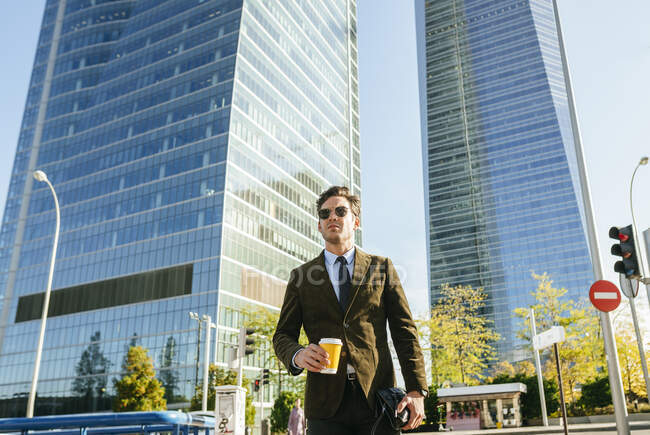 Confident businessman walking in urban business district, Madrid, Spain — Stock Photo