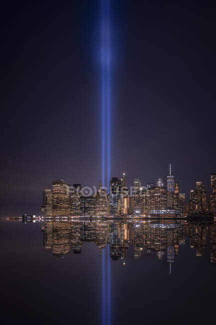 USA, New York, New York City, Manhattan skyline with Tribute in Light at night — Stock Photo