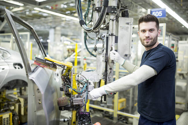 Portrait of confident worker in modern car factory — Stock Photo