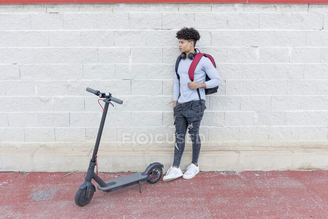 Young man with e-scooter outdoors — Stock Photo