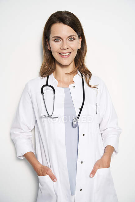 Portrait of smiling female doctor with stethoscope — Stock Photo