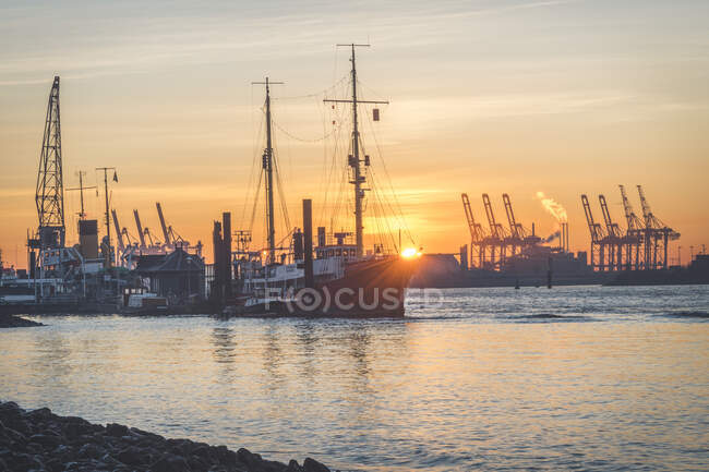 View of harbor against sky during sunrise at Hamburg, Germany — Stock Photo
