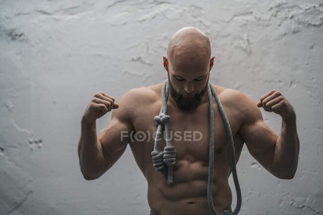Portrait of a barechested athlete with rope — Stock Photo