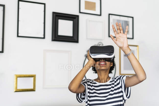 Young woman with VR glasses at home — Stock Photo