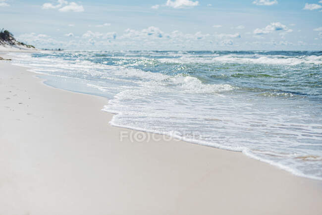Sea waves reaching at shore in Poland during sunny day — Stock Photo