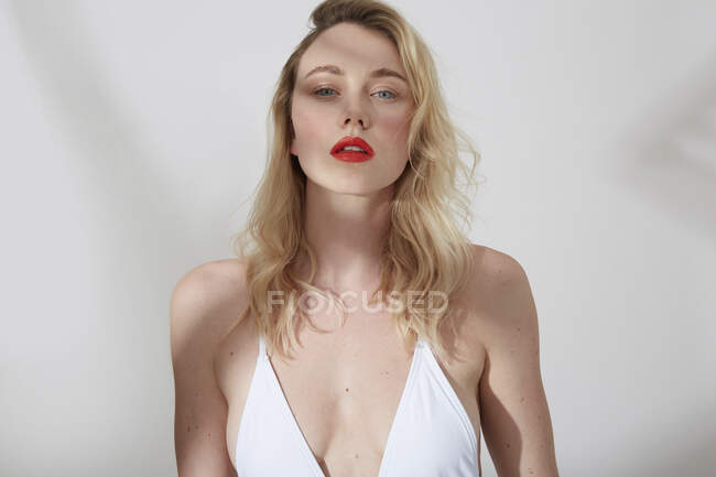 Portrait of young blond woman with red lips — Stock Photo