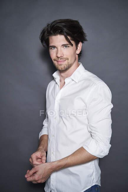 Portrait of handsome man wearing white shirt — Stock Photo