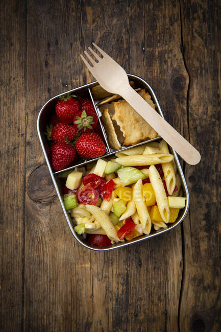 High angle view of lunch box on wooden table — Stock Photo