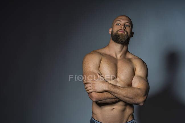 Portrait of a barechested athlete in studio — Stock Photo
