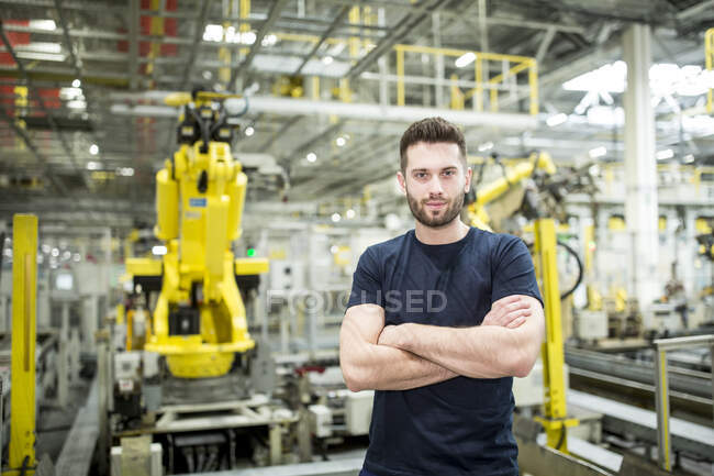 Portrait of confident worker in a modern factory — Stock Photo