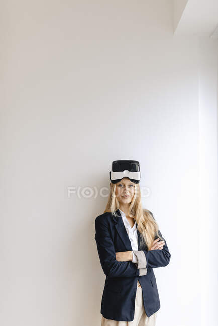 Portrait of young businesswoman wearing VR glasses — Stock Photo