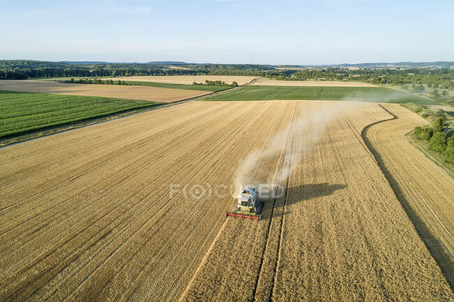 Germany, Bavaria, Drone view of combine harvester working in field — Stock Photo