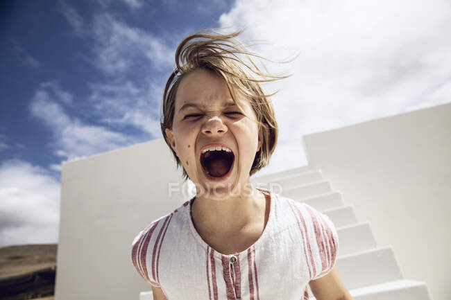 Girl with windswept hair, screaming out loud — Stock Photo