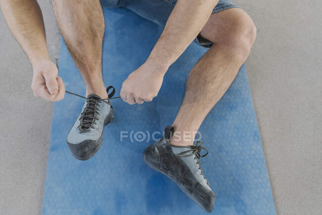 Close-up of man putting on climbing shoes — Stock Photo